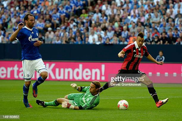 Goalkeeper Timo Hildebrand of Schalke challenges Stephen El Shaarawy of Milan during the friendly match between Schalke 04 and AC Milan at...