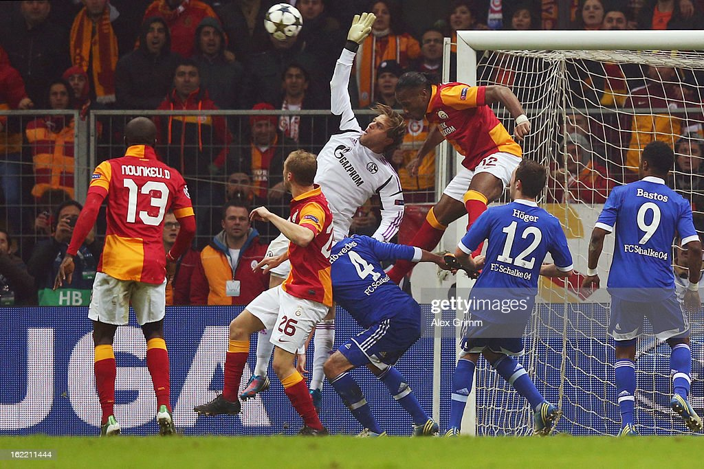 Goalkeeper Timo Hildebrand of Schalke is challenged by Didier Drogba of Galatasaray during the UEFA Champions League Round of 16 first leg match between Galatasaray and FC Schalke 04 at the Turk Telekom Arena on February 20, 2013 in Istanbul, Turkey.