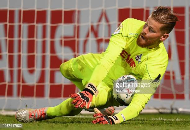 Goalkeeper Timo Horn of 1. FC Koeln saves a penalty against Goekhan Guel of SV Wehen Wiesbaden during the DFB Cup first round match between SV Wehen...