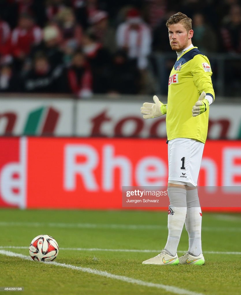Goalkeeper Timo Horn of Cologne lifts his arms during the Bundesliga match between 1. FC Koeln and Hannover 96 at RheinEnergieStadion on February 21, 2015 in Cologne, Germany.