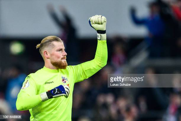 Goalkeeper Timo Horn of Koeln celebrates his team's first goal during the DFB Cup match between 1. FC Koeln and FC Schalke 04 at RheinEnergieStadion...
