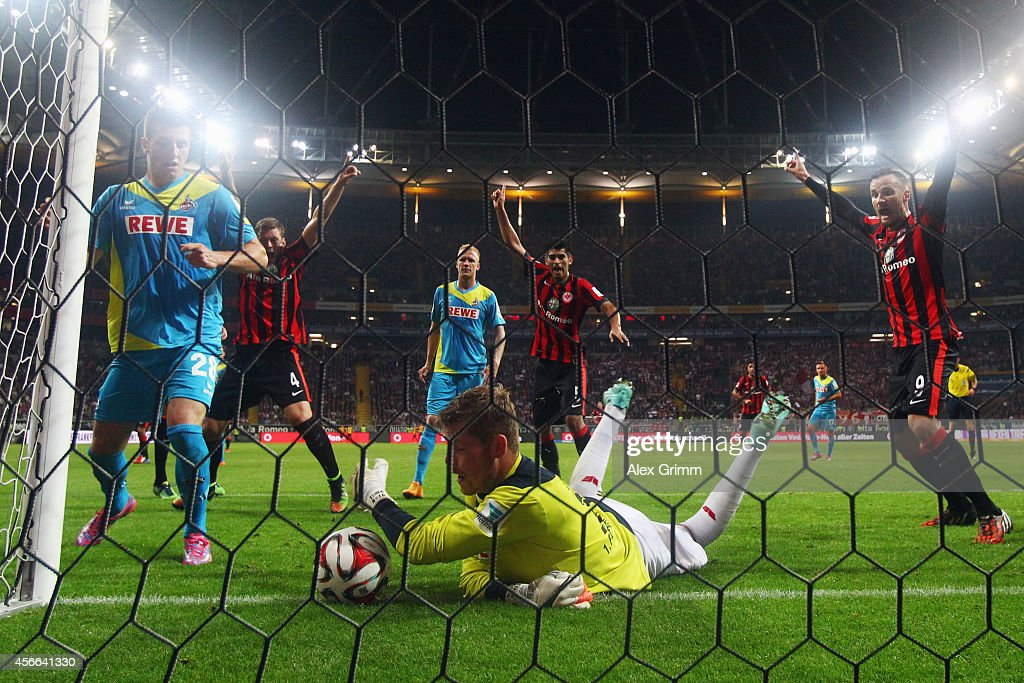Goalkeeper Timo Horn of Koeln saves the ball behind the goal line for Frankfurt's third goal during the Bundesliga match between Eintracht Frankfurt and 1. FC Koeln at Commerzbank-Arena on October 4, 2014 in Frankfurt am Main, Germany.