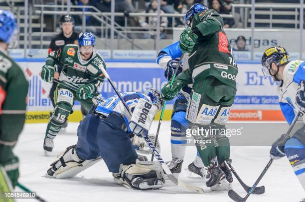goalkeeper Timo Pielmeier of ERC Ingolstadt and Adam Payerl of AEV Augsburger Panther battle for the ball during the DEL match between AEV Augsburger...