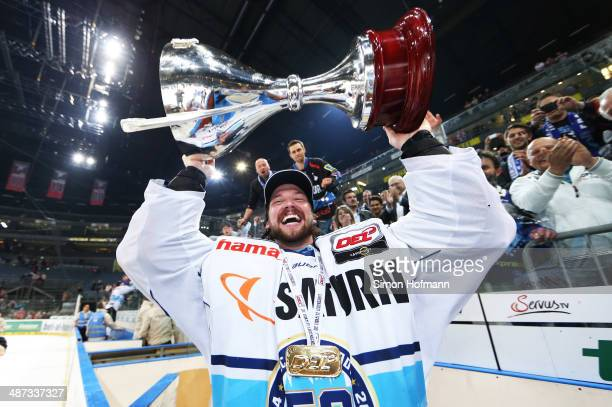 Goalkeeper Timo Pielmeier of Ingolstadt celebrates winning after game seven of the DEL final playoffs between Koelner Haie and ERC Ingolstadt at...