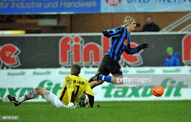 Goalkeeper Tobias Linse of Aalen stopps Soeren Brandy of Paderborn during the 3 Bundesliga match between SC Paderborn and VFR Aalen at the Paragon...