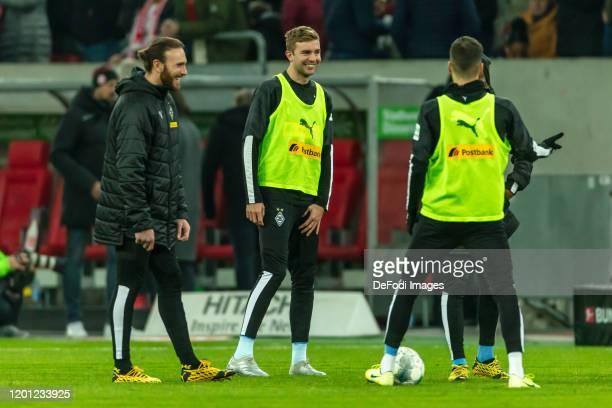 goalkeeper Tobias Sippel of Borussia Moenchengladbach and Christoph Kramer of Borussia Moenchengladbach smiles during the Bundesliga match between...