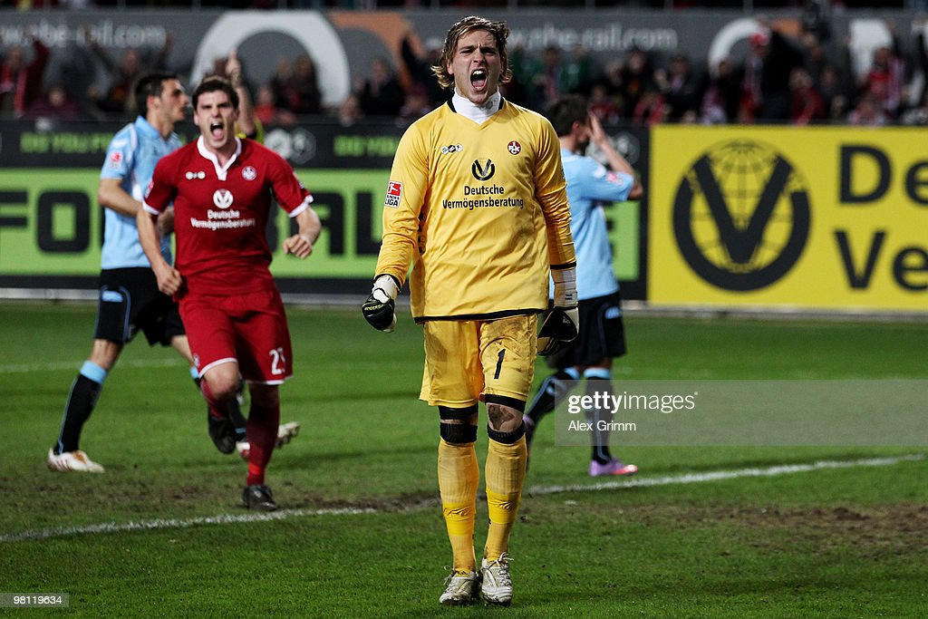 Goalkeeper Tobias Sippel of Kaiserslautern celebrates with team mate Florian Dick (L) after parrying a penalty by Alexander Ludwig (R) of Muenchen during the Second Bundesliga match between 1. FC Kaiserslautern and 1860 Muenchen at the Fritz-Walter Stadium on March 29, 2010 in Kaiserslautern, Germany.