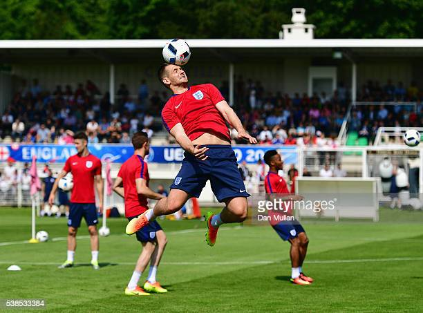Goalkeeper Tom Heaton heads the ball during an England training session ahead of the UEFA EURO 2016 at Stade du Bourgognes on June 7 2016 in...
