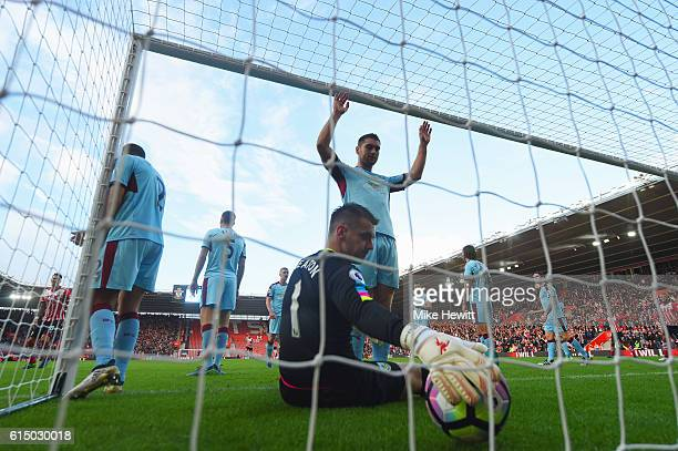 Goalkeeper Tom Heaton of Burnley and team mates look dejected as Charlie Austin of Southampton scores their first goal during the Premier League...