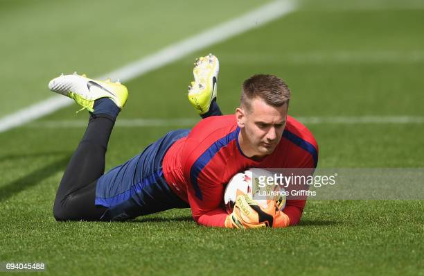Goalkeeper Tom Heaton of England holds the ball during an England training session on the eve of their FIFA World Cup qualifier against Scotland at...