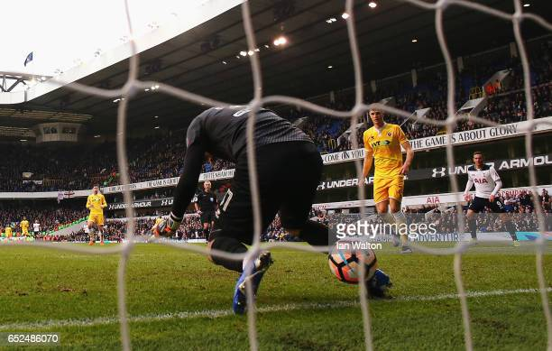 Goalkeeper Tom King of Millwall fumbles the ball as he fails to stop HeungMin Son of Tottenham Hotspur scoring their sixth goal and completes his hat...