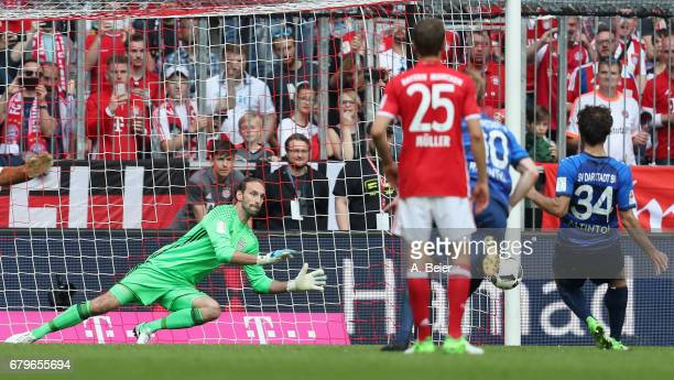Goalkeeper Tom Starke of FC Bayern Muenchen saves a penalty shot by Halil Altintop of SV Darmstadt during the Bundesliga match between Bayern...