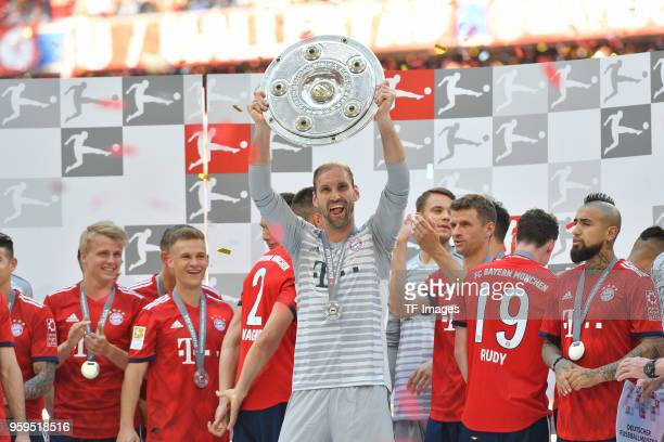 Goalkeeper Tom Starke of Muenchen celebrates winning the championship after the Bundesliga match between FC Bayern Muenchen and VfB Stuttgart at...