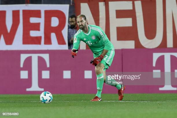 Goalkeeper Tom Starke of Muenchen controls the ball during the Friendly match between Al-Ahli and Bayern Muenchen at Aspire Academy on January 06,...