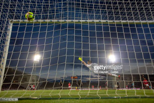 April 9: Goalkeeper Tomas Koubek of Rennes is beaten by a shot from Antonin Bobichon of Nimes for Nimes third goal of the match during the Nimes V...