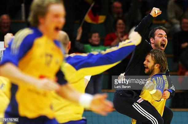 Goalkeeper Tomas Svensson of Sweden celebrates with team mate Magnus Jernemyr after winning the Men's Handball European Championship main round Group...