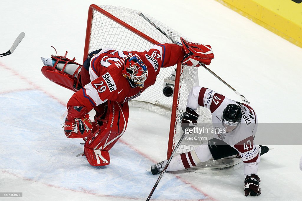 Goalkeeper Tomas Vokoun of Czech Republic is challenged by Martins Cipulis of Latvia during the IIHF World Championship group F qualification round match between Czech Republic and Latvia at SAP Arena on May 17, 2010 in Mannheim, Germany.