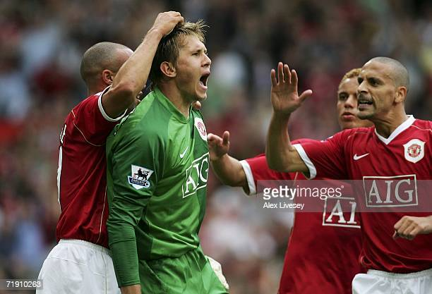 Goalkeeper Tomasz Kusczak of Manchester United celebrates after saving the penalty from Gilberto Silva of Arsenal during the Barclays Premiership...