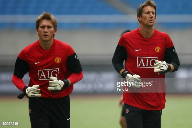Goalkeeper Tomasz Kuszczak and Edwin Van der Sar of Manchester United train during a training session as part of the club's Asia Tour 2009 at Huang...