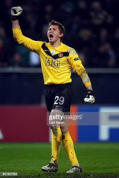 Goalkeeper Tomasz Kuszczak of Manchester celebrates after team mate Michael Owen scored the first goal during the UEFA Champions League Group B match...
