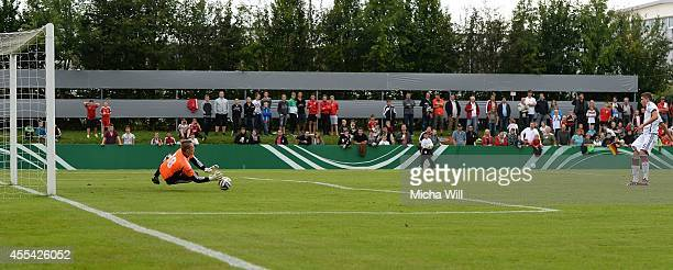 Goalkeeper Tomer Litvinov of Israel paries a penalty shot by Guel Goekhan of Germany during the KOMM MIT tournament match between U17 Germany and U17...