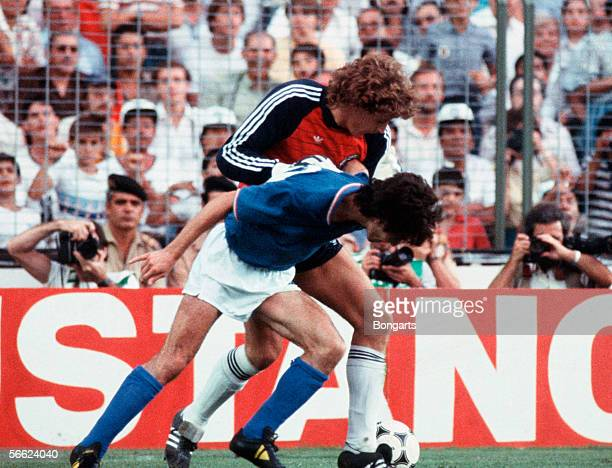 Goalkeeper Toni Schumacher of Germany and Paolo Rossi of Italy in action during the World Cup final match between Italy and Germany on July 11, 1982...