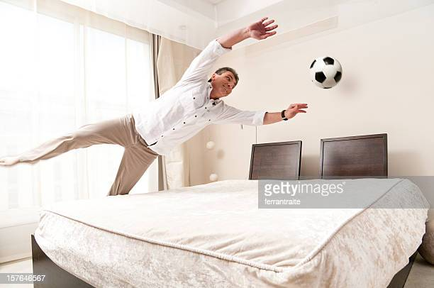 Goalkeeper training in hotel bed room