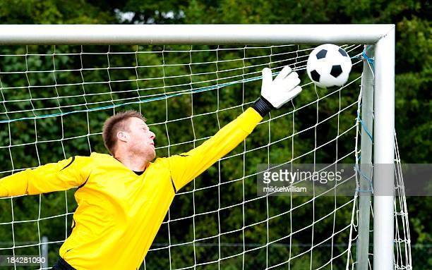 Goalkeeper tries to block perfect shot