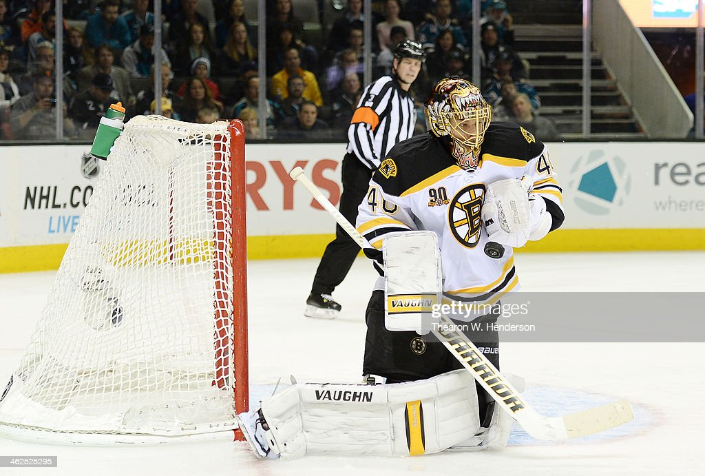 Goalkeeper Tuukka Rask #40 of the Boston Bruins blocks a shot against the San Jose Sharks during the second period at SAP Center on January 11, 2014 in San Jose, California.