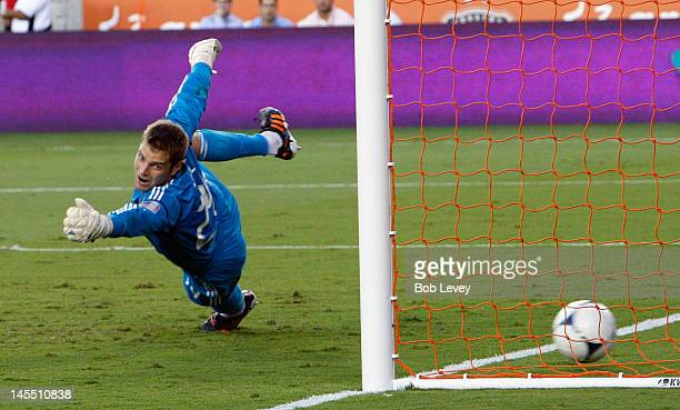 Goalkeeper Tyler Deric of the Houston Dynamo dives but misses the save on a shot by Aritz Aduriz of Valencia at BBVA Compass Stadium on May 31, 2012...
