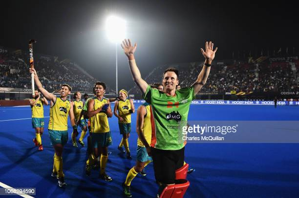 Goalkeeper Tyler Lovell of Australia celebrates victory with team mates after the FIH Men's Hockey World Cup Group B match between England and...