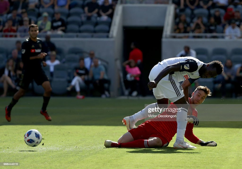 Goalkeeper Tyler Miller #1 of Los Angeles FC makes a sliding save on a play to the net by C.J. Sapong #17 of Philadelphia Union during the first half of the MLS match at Banc of California Stadium on June 30, 2018 in Los Angeles, California. Los Angeles FC defeated the Philadelphia Union 4-1.