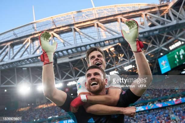 Goalkeeper Unai Simon of Spain celebrates with teammate Cesar Azpilicueta after winning the penalty shots of the UEFA Euro 2020 Championship...