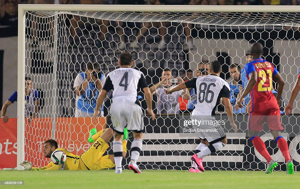 Goalkeeper Valentin Cojocaru (L) of FC Steaua Bucharest saves a penalty kick taken by Valery Bozhinov (R) of FC Partizan Belgrade during the UEFA Champions League Third Qualifying Round Second Leg match between FC Partizan Belgrade and FC Steaua Bucharest at FC Partizan stadium on August 05, 2015 in Belgrade, Serbia.