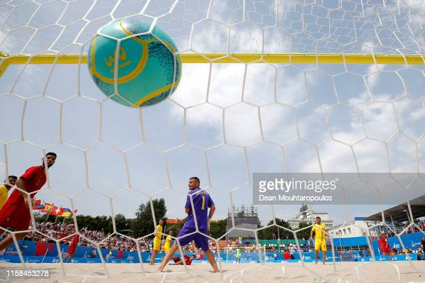 Goalkeeper Valentin Dumitrica of Romania is beaten by Joao Goncalves of Portugal scissor or bicycle kick shot on goal during the Beach Soccer or...