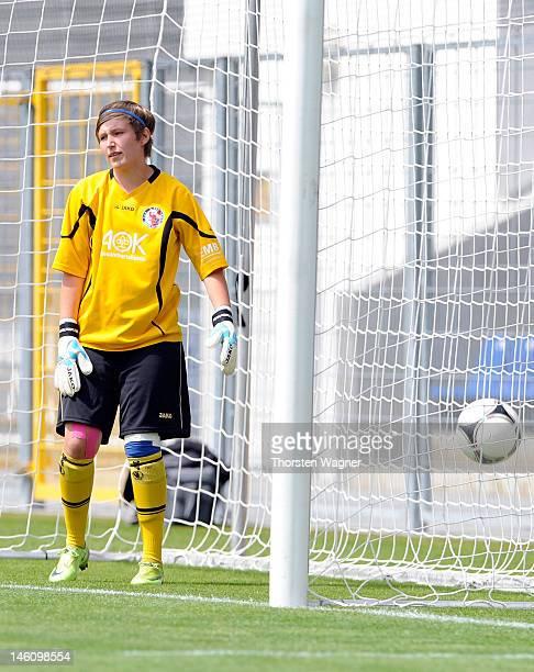 Goalkeeper Vanessa Fischer of Potsdam looks dejected after Lisa Eiberg of Hoffenheim is scorin her teams second goal during the women's bjuniors...