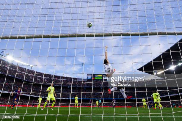 Goalkeeper Vicente Guaita of Getafe CF clears the ball during the La Liga match between Barcelona and Getafe at Camp Nou on February 11 2018 in...