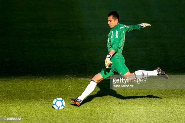 Brenner of Botafogo struggles for the ball with Iago Maidana and goalkeeper Victor of Atletico during a match between Botafogo and Atletico MG as...