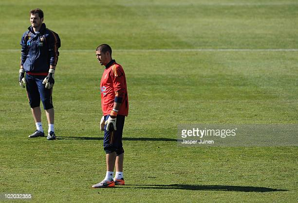 41ad54bd73c Goalkeeper Victor Valdes of Spain stands backdropped by his teammate  goalkeeper Iker Casillas of Spain during