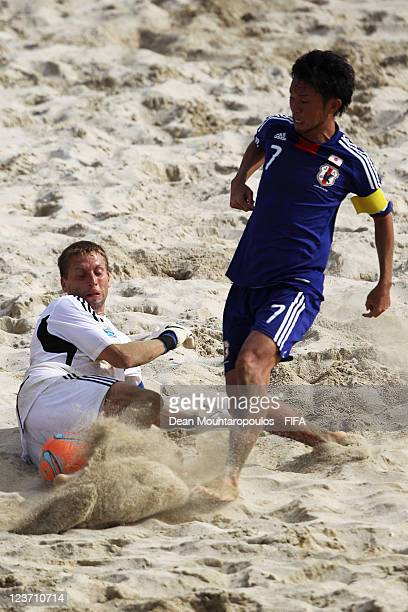 Goalkeeper, Vitalii Sydorenko of Ukraine and Takeshi Kawaharazuka of Japan battle for the ball during the FIFA Beach Soccer World Cup Group D match...