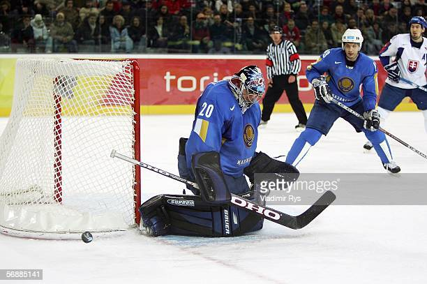 Goalkeeper Vitaliy Kolesnik of Kazakhstan lowers his head during play in the third period of the men's ice hockey Preliminary Round Group B match...