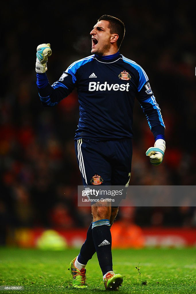 Goalkeeper Vito Mannone of Sunderland celebrates after making a save in the penalty shootout during the Capital One Cup semi final, second leg match between Manchester United and Sunderland at Old Trafford on January 22, 2014 in Manchester, England.
