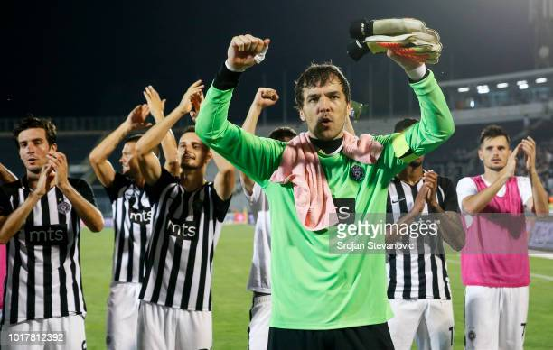 Goalkeeper Vladimir Stojkovic celebrates with team mates after the UEFA Europa League Third Round Qualifier Second Leg match between Partizan and...