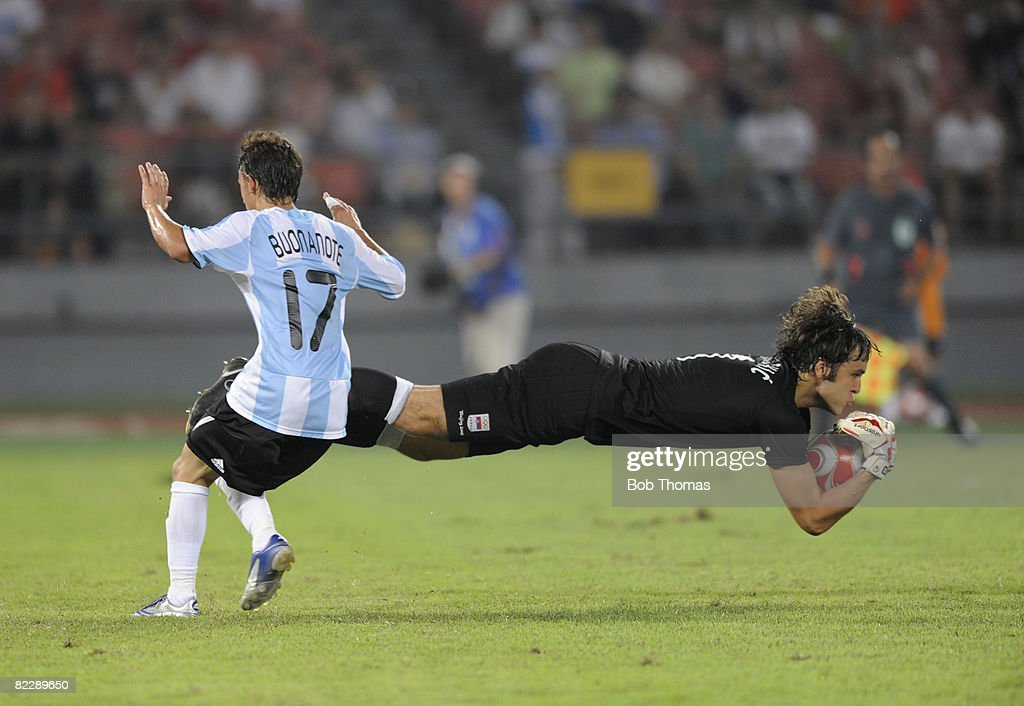 Goalkeeper Vladimir Stojkovic of Sebia catches the ball from Diego Buonanotte of Argentina during the Men's First Round Group A match between Argentina and Serbia at the Workers' Stadium on Day 5 of the Beijing 2008 Olympic Games on August 13, 2008 in Beijing, China.