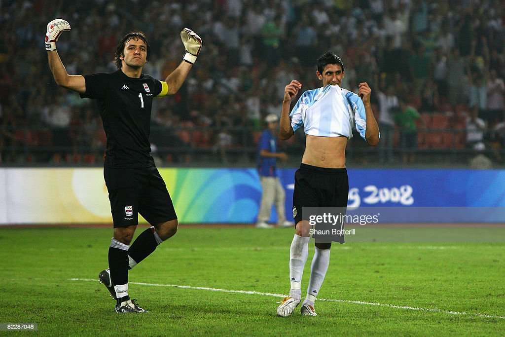 Goalkeeper Vladimir Stojkovic of Serbia celebrates after saving a penalty by Angel di Maria (R) of Argentina during the Men's First Round Group A match between Argentina and Serbia at the Workers' Stadium on Day 5 of the Beijing 2008 Olympic Games on August 13, 2008 in Beijing, China.