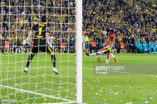 goalkeeper Volkan Demirel of Fenerbahce SK Bafetimbi Gomis of Galatasaray SK Martin Skrtel of Fenerbahce SK during the Turkish Spor Toto Super Lig...