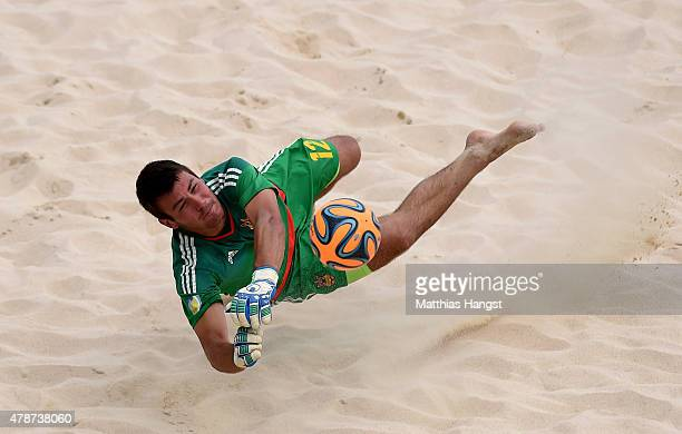 Goalkeeper Volodymyr Hladchenko of Ukraine makes a save during the Men's Beach Soccer play off 5th/8th place match between Ukraine and Hungary on day...