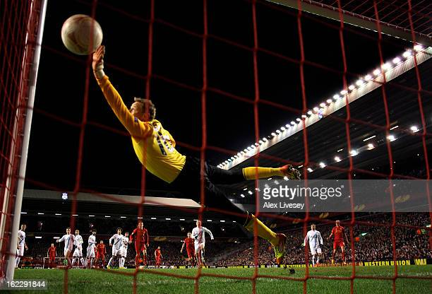 Goalkeeper Vyacheslav Malafeev of Zenit dives in vain as Luis Suarez of Liverpool scores a goal from a second half free kick during the UEFA Europa...