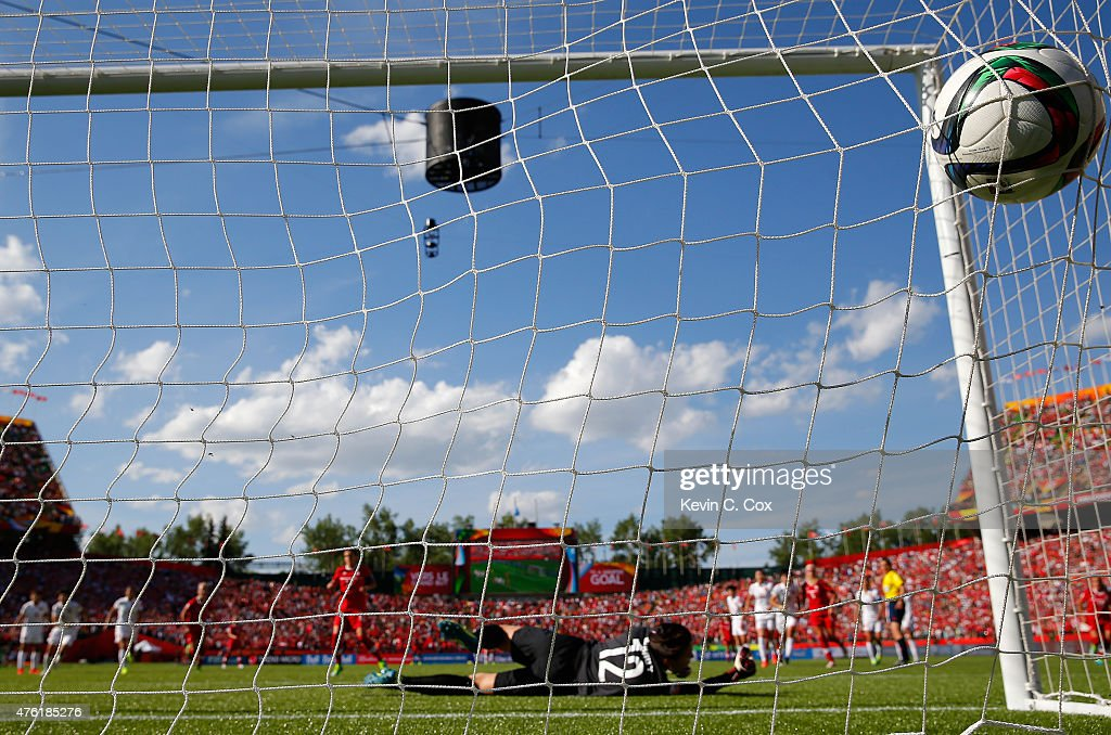 Goalkeeper Wang Fei #12 of China PR dives as the go-ahead goal from Christine Sinclair #12 of Canada enters the back of the net during the FIFA Women's World Cup Canada 2015 Group A match between Canada and China PR at Commonwealth Stadium on June 6, 2015 in Edmonton, Canada.