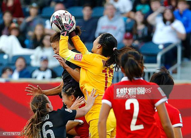 Goalkeeper Wang Fei of China PR saves a shot against Amber Hearn and Annalie Longo of New Zealand during the FIFA Women's World Cup Canada 2015 Group...